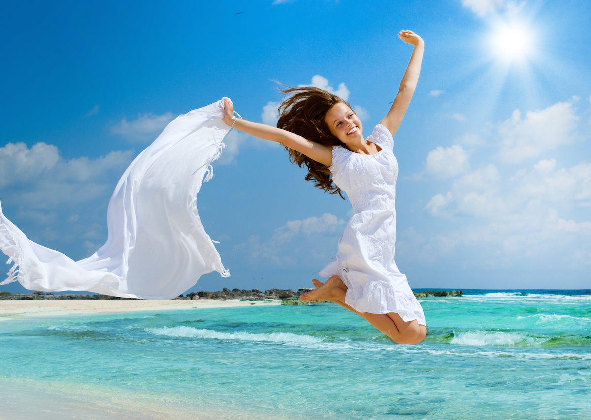 Beautiful Girl With White Scarf Jumping on The Beach